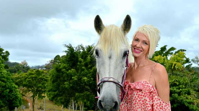 Breast cancer survivor Janet Kake says her horses, including Budismo (pictured), have been key to helping her heal.