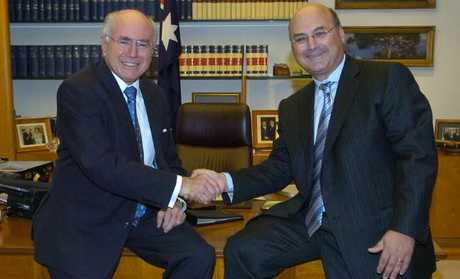 Prime Minister John Howard with his Chief of Staff Arthur Sinodinos on Arthur's final day in the job, in the PM's office in Parliament House, Canberra. Picture: Supplied Source:News Limited