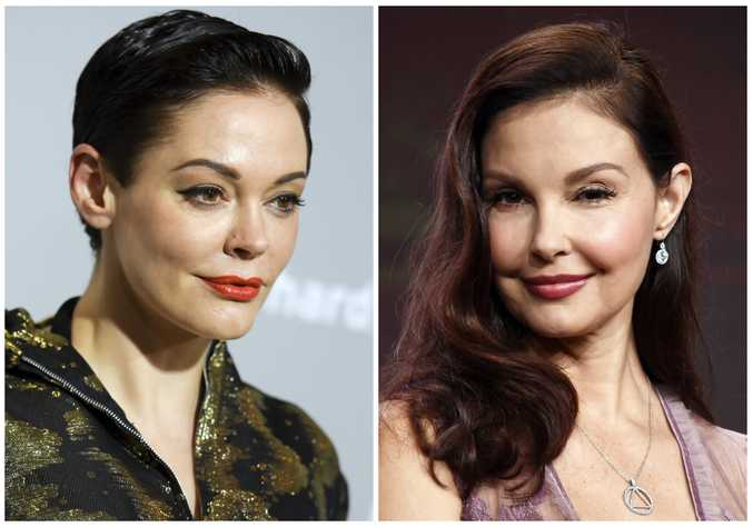 This combination photo shows actors, Rose McGowan at a premiere in Los Angeles on April 15, 2015, left, and Ashley Judd in Beverly Hilla, Calif. on July 25, 2017. Producer Harvey Weinstein is taking a leave of absence from his company after The New York Times released a report alleging decades of sexual harassment against women, including employees and actress Ashley Judd. The Times reports two co