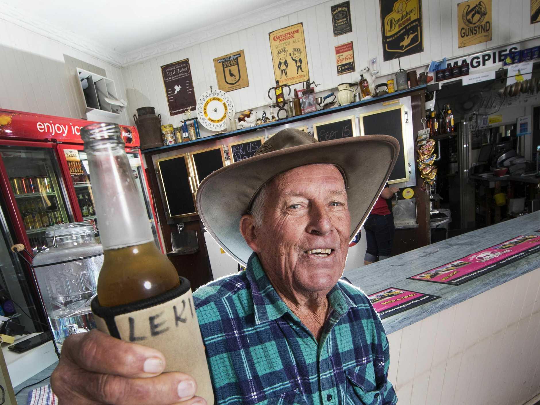 CHAMPION: 74-year-old Lex Cawthray enjoys a stubby.