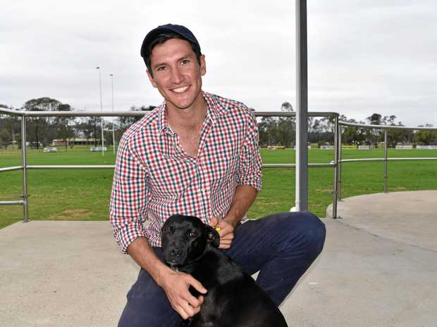 HEARTWARMING: Cody Cook with his newly adopted rescue dog Mia.