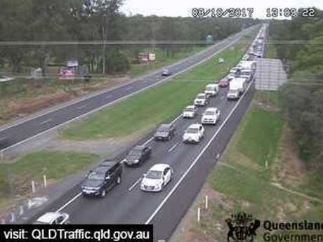 Northbound Bruce Hwy traffic queues at Caboolture after a serious crash blocked all lanes at Elimbah.