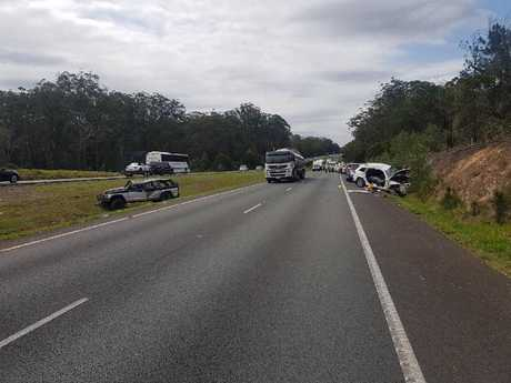 Forensic Crash Unit officers investigate the scene of a serious crash on the Bruce Hwy at Elimbah.
