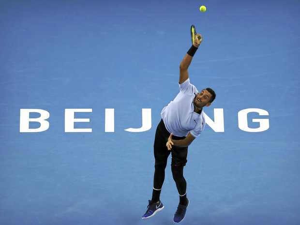 Nick Kyrgios serves to Alexander Zverev of Germany during their singles semi-final match at the China Open at the Diamond Court in Beijing.