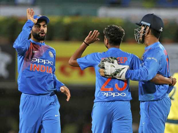 Indian captain Virat Kohli, left, congratulates Kuldeep Yadav for the wicket of Australia's Aaron Finch in the first T20 international in Ranchi.