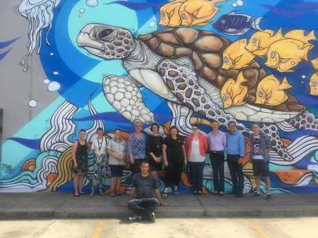 PUBLIC ART: Artists Tim Phibs and his turtle mural with representatives from Hinkler Central, Creative Regions, Bundaberg Regional Council, Bundaberg North Burnett Tourism, Queensland Parks and Wildlife and Bundaberg Regional Art Gallery