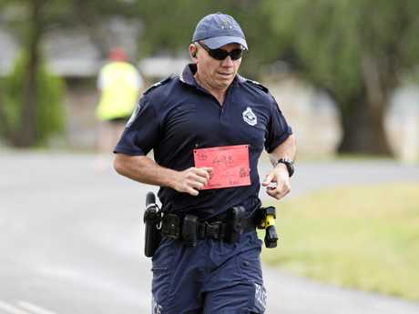 Toowoomba police officer Geordie Horn runs the half marathon in full police kit in honour of fallen college Brett Forte in the Athletes Foot Roger Guard Toowoomba Marathon, Sunday, October 8, 2017.