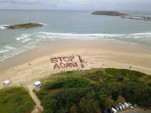 'Stop Adani' taken to the sand of Coffs Harbour beach