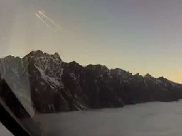 The video starts off with stunning snow-capped mountains as the pilot descends in to Queenstown airport.