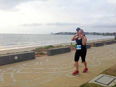 Katherine Keiler gives the thumbs up as she and dad Lance Price take on the Yeppoon course.