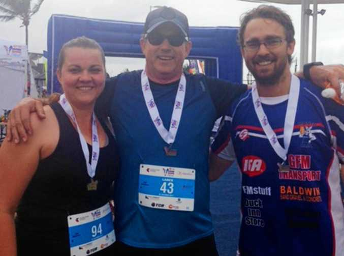 MAJOR MILESTONE: Lance Price (centre) with his daughter Katherine Keiler and son David Price after they completed the half marathon.