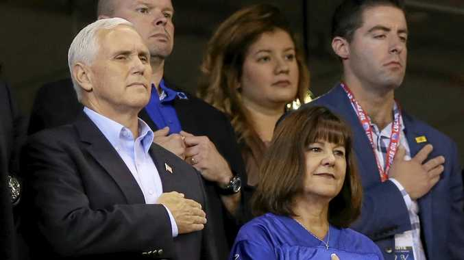 Vice-President Mike Pence and his wife Karen stand for the National Anthem.