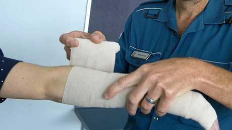 STEP 3: A compression bandage being applied to the whole limb, leaving the fingers exposed.