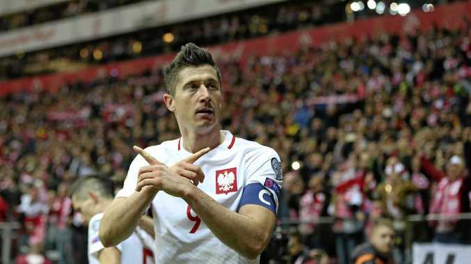 Poland's Robert Lewandowski celebrates scoring in the win over Montenegro.