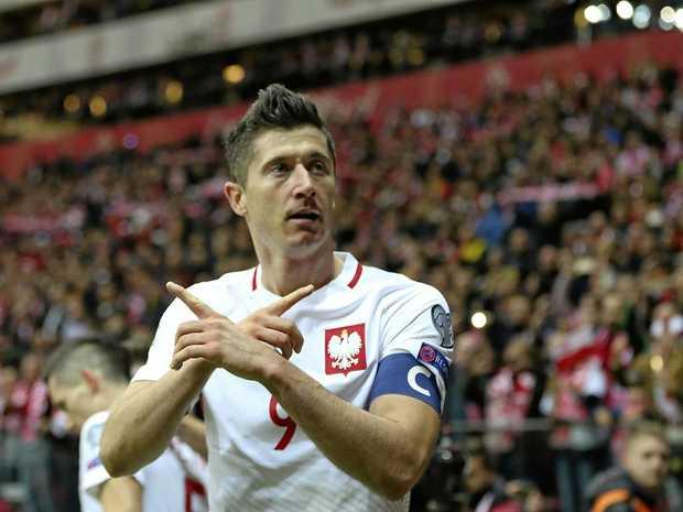 Poland's Robert Lewandowski celebrates scoring in the win over Montenegro.