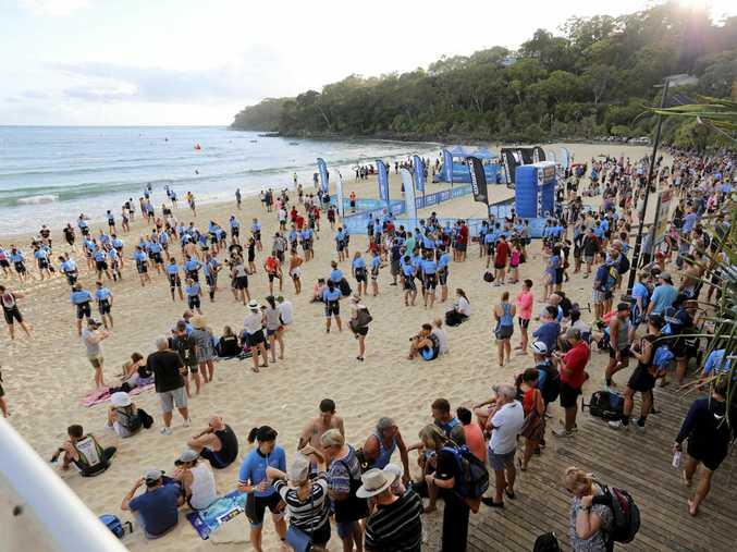 POPULAR: Spectators and athletes enjoy the 2016 Noosa Triathlon, before the start of swim leg at Noosa Main Beach.