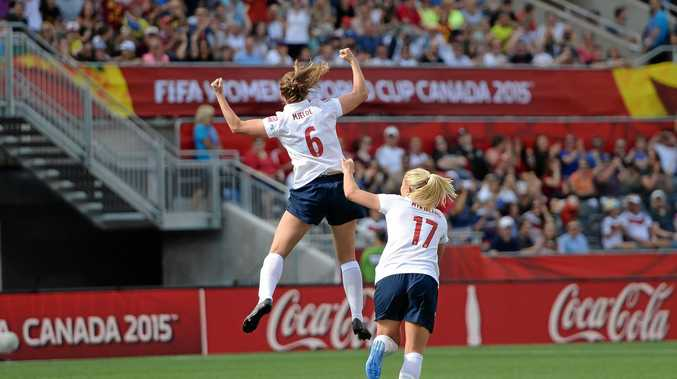 Norway's Maren Mjelde, left, celebrates her goal with teammate Lene Mykjaland during the second half against Germany in a FIFA Women's World Cup soccer match in Ottawa, Ontario, Canada, Thursday, June 11, 2015. (Sean Kilpatrick/The Canadian Press via AP