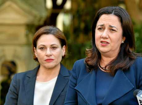 Premier Annastacicia Palaszczuk (right) speaks to the media at Parliament House on August 23.