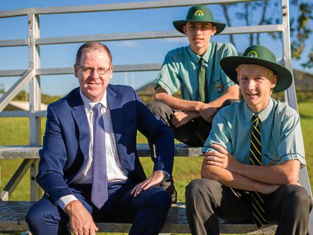 St Brendan's College Principal Nick Scully with current students Reuben Whyte (front) and Hayden Ingram (back).
