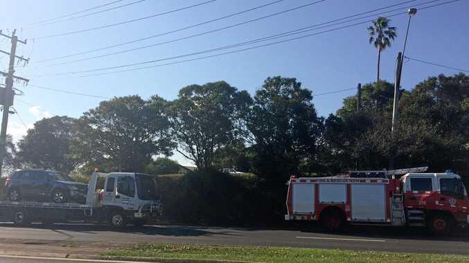 A car is towed after it flipped on its side on Ballina Road near the Rotary Drive roundabout.