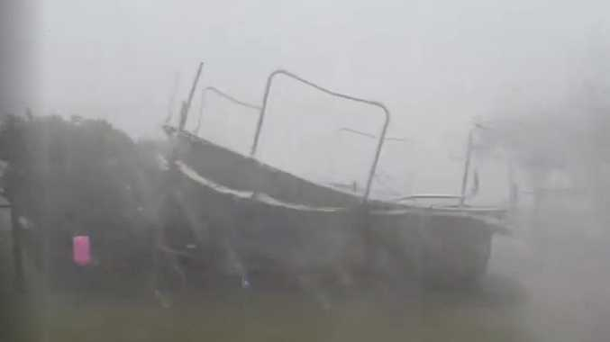 A trampoline went flying near a Maryborough home, nearly hitting a man who was looking outside at the wild weather.
