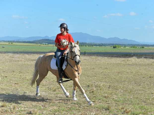 Katie Morrow gallops clear at the Horseball clinic at Mirani.