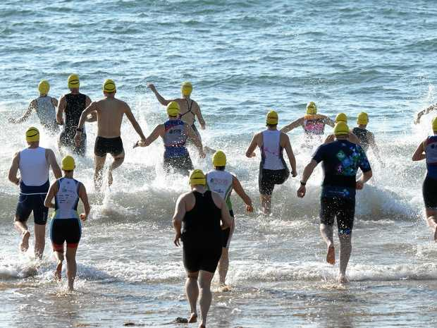 THEY'RE OFF: Competitors race into action in the Fitzroy Frogs Triathlon Club's first event of the season at Emu Park on Sunday.