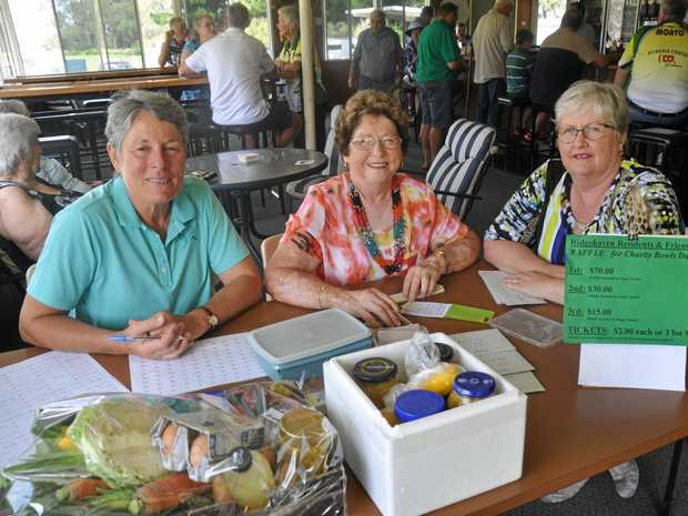 FUNDRAISER DAY: Patsy Aisthorpe, Colleen Kerr and Tracey Pattie taking names for the Ridgehaven Charity Day at Monto.