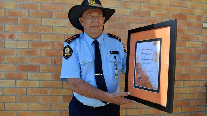 TOP HONOUR: Brian Lowe with the award for the North Coast Regional SES Operational Response of the Year.