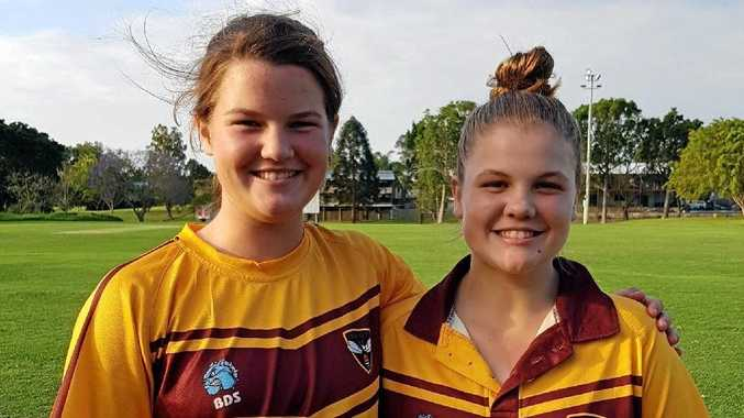 ALL SMILES: Hornets stars Ruth Johnston and Georgia Voll will represent Qld at the u18 national championships. .