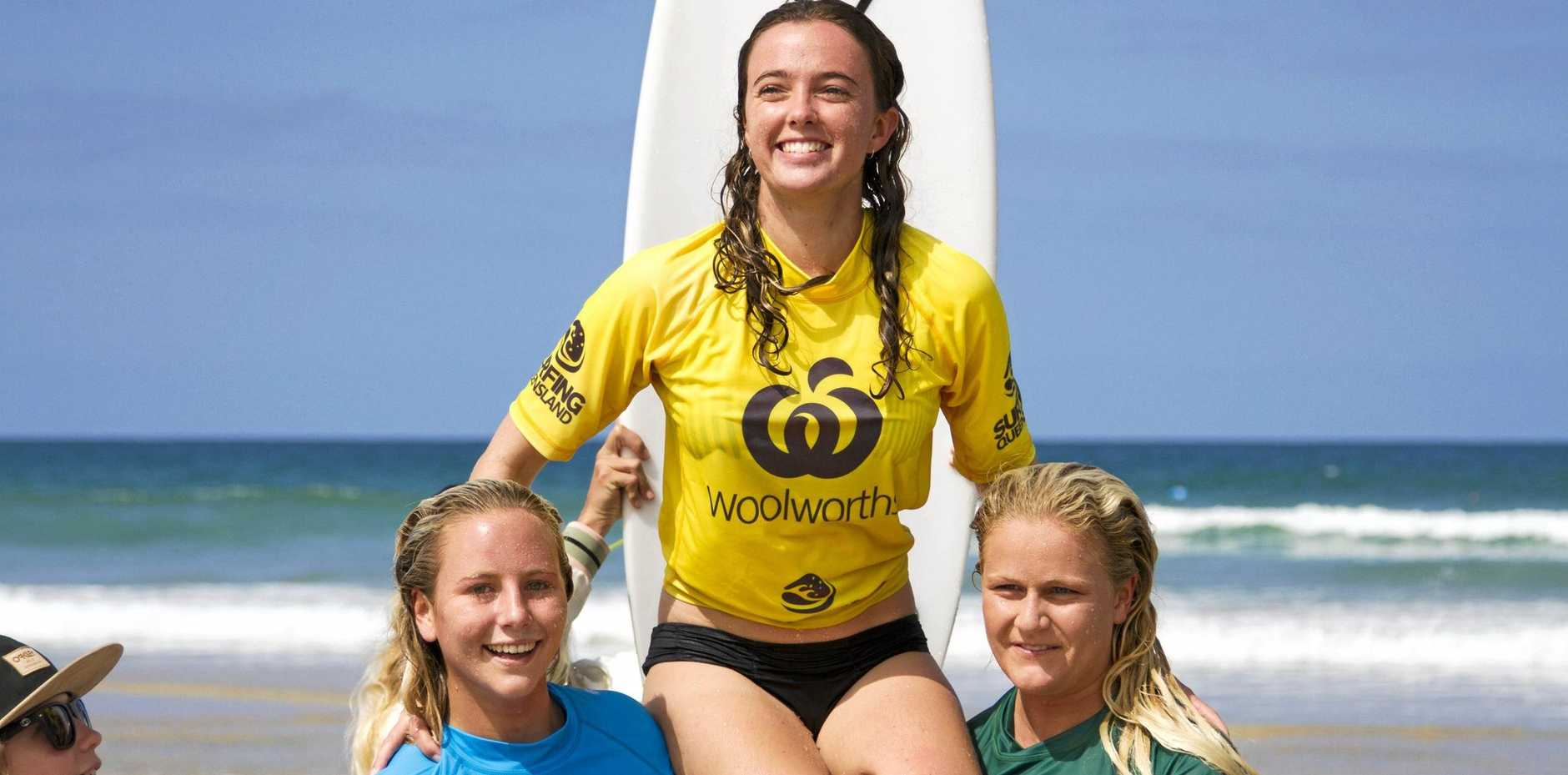 TRIUMPHANT: Amber Dods is chaired up the beach after winning the under-18 girls state title at Coolum.