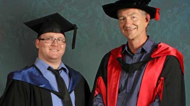 NEW GRAD: Cody Smith with USC Professor of Criminology Tim Prenzler at the graduation ceremony last month.