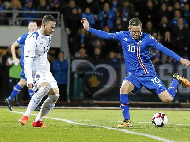 Iceland's scorer Gylfi Sigurdsson takes a shot at Kosovo's goal during the World Cup qualifying match in Reykjavik