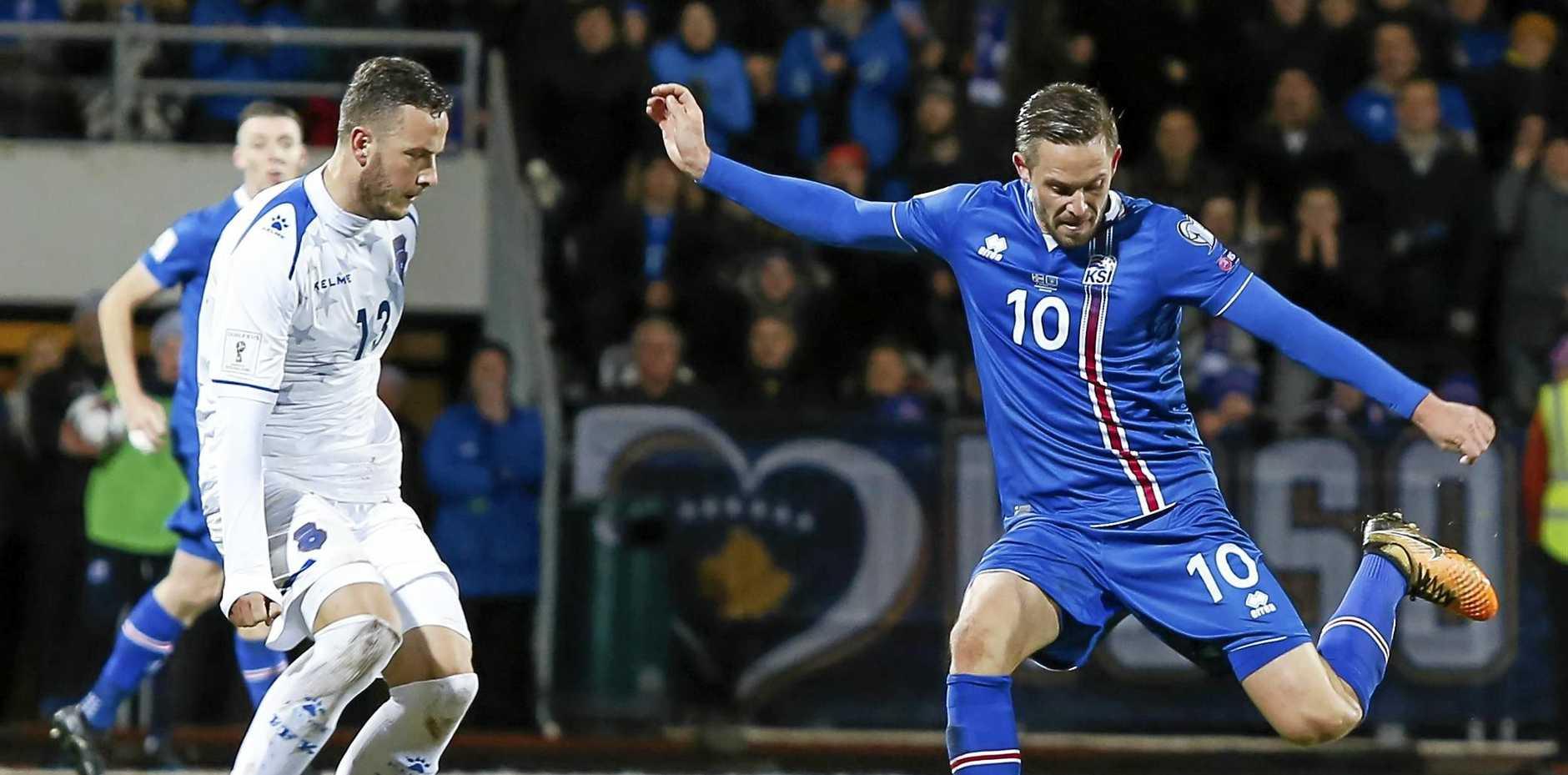 Iceland's scorer Gylfi Sigurdsson takes a shot at Kosovo's goal during the World Cup qualifying match in Reykjavik