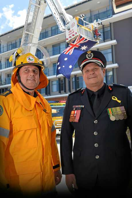 REMEMBRANCE DAY: Flags were flown at half-mask at fire stations around the state to pay tribute to all firefighters who made th eultimate sacrifice in the line of duty. First officer Mark Smith of Doonan Rural Fire Station and assistant commissioner of the North Coast region John Cawcutt.
