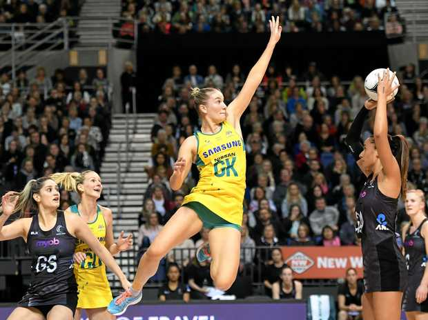 Courtney Bruce (centre) defends against Maria Tutaia of New Zealand in the netball Constellation Cup between New Zealand and Australia on Sunday
