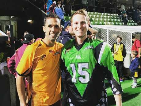 Ipswich and Queensland Blades goalkeeper Cade Banditt (right) shares a moment with Australian player Mark Knowles at the AHL championships in Perth.