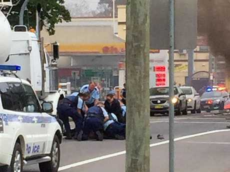 Arrest... The dramatic moment the driver of the truck is wrestled to the ground. Picture: Hit 106.9 Newcastle