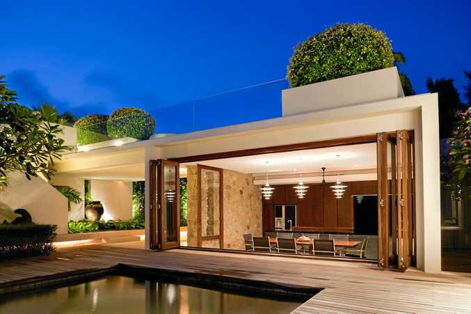 Create flow by blurring the lines between indoor and outdoor living spaces.