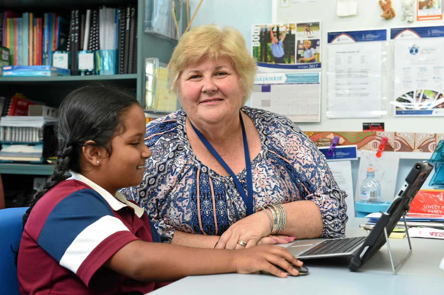 Fraser Coast Anglican College teacher Leanne Collins with year 3 student Nilima Guha.