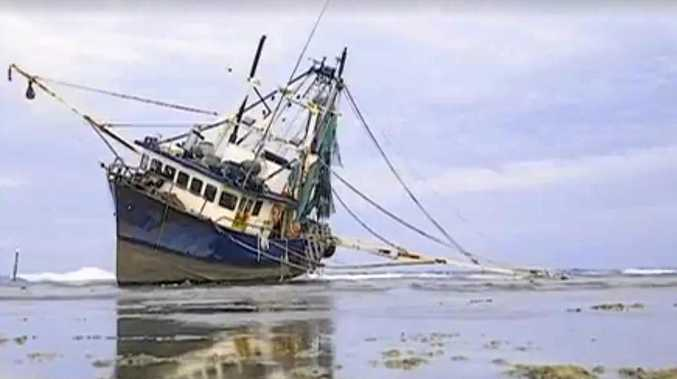 STRANDED: Marine authorities are developing a plan to remove this 50-metre fishing trawler from where it ran aground on Lady Musgrave Island.