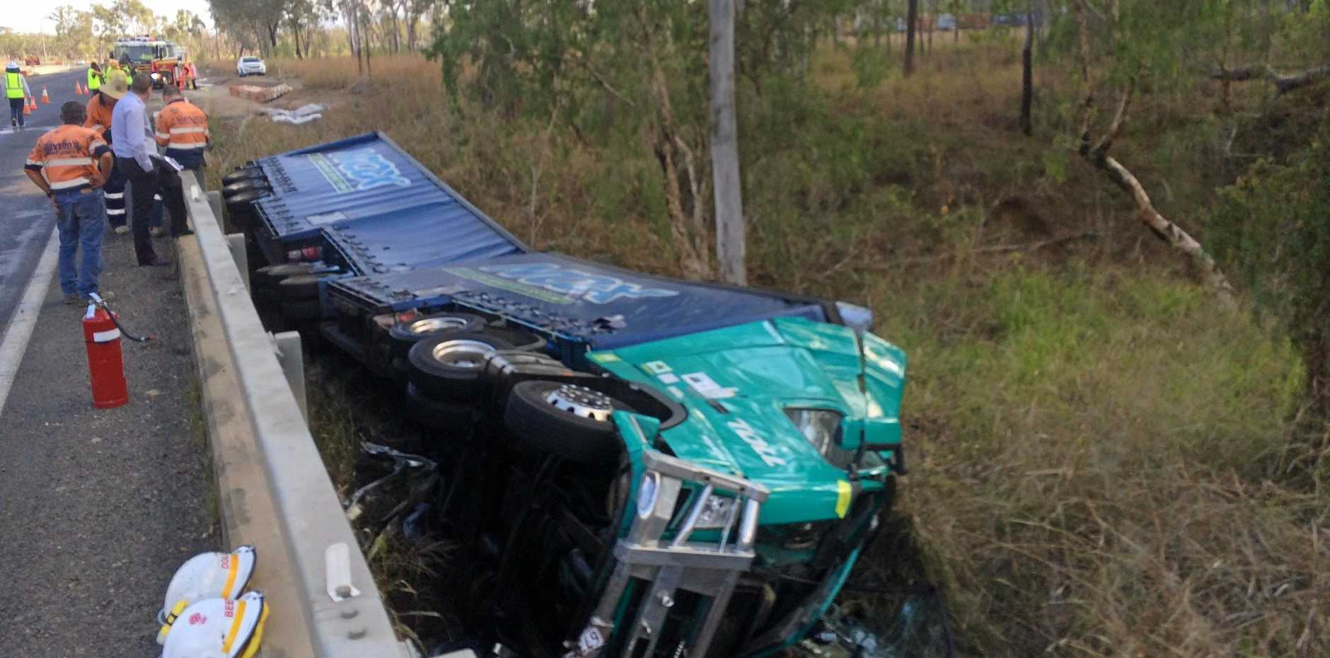 A Toll B-double truck has come off the road and into Midgee Creek, south of Rockhampton.