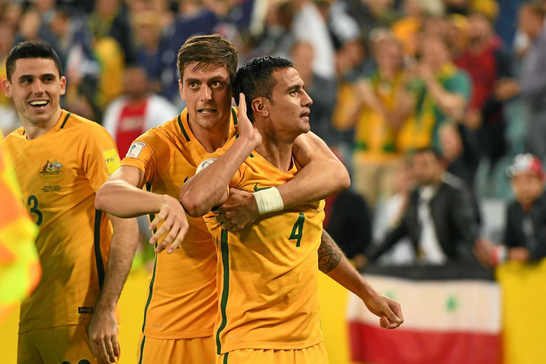 Tim Cahill gestures to the crowd after his match-winning goal.