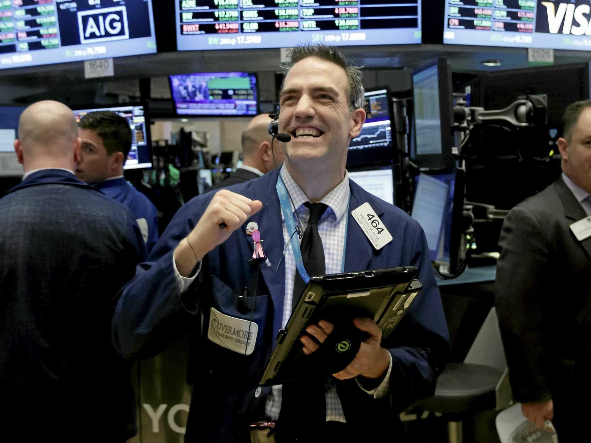 A trader in the New York Stock Exchange reacts at the closing bell as the Dow Jones Industrial Average closes above the 20,000 mark for the first time, in January this year.