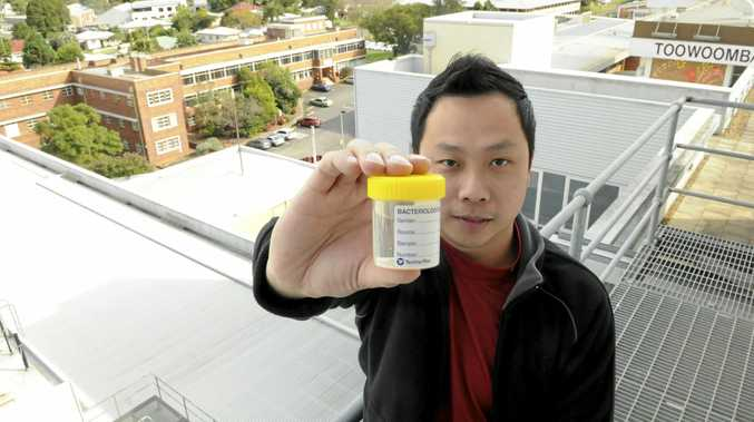 Toowoomba Hospital Engineering Manager Kevin Tan with a sample of water from tests to check for the Legionella bacteria.
