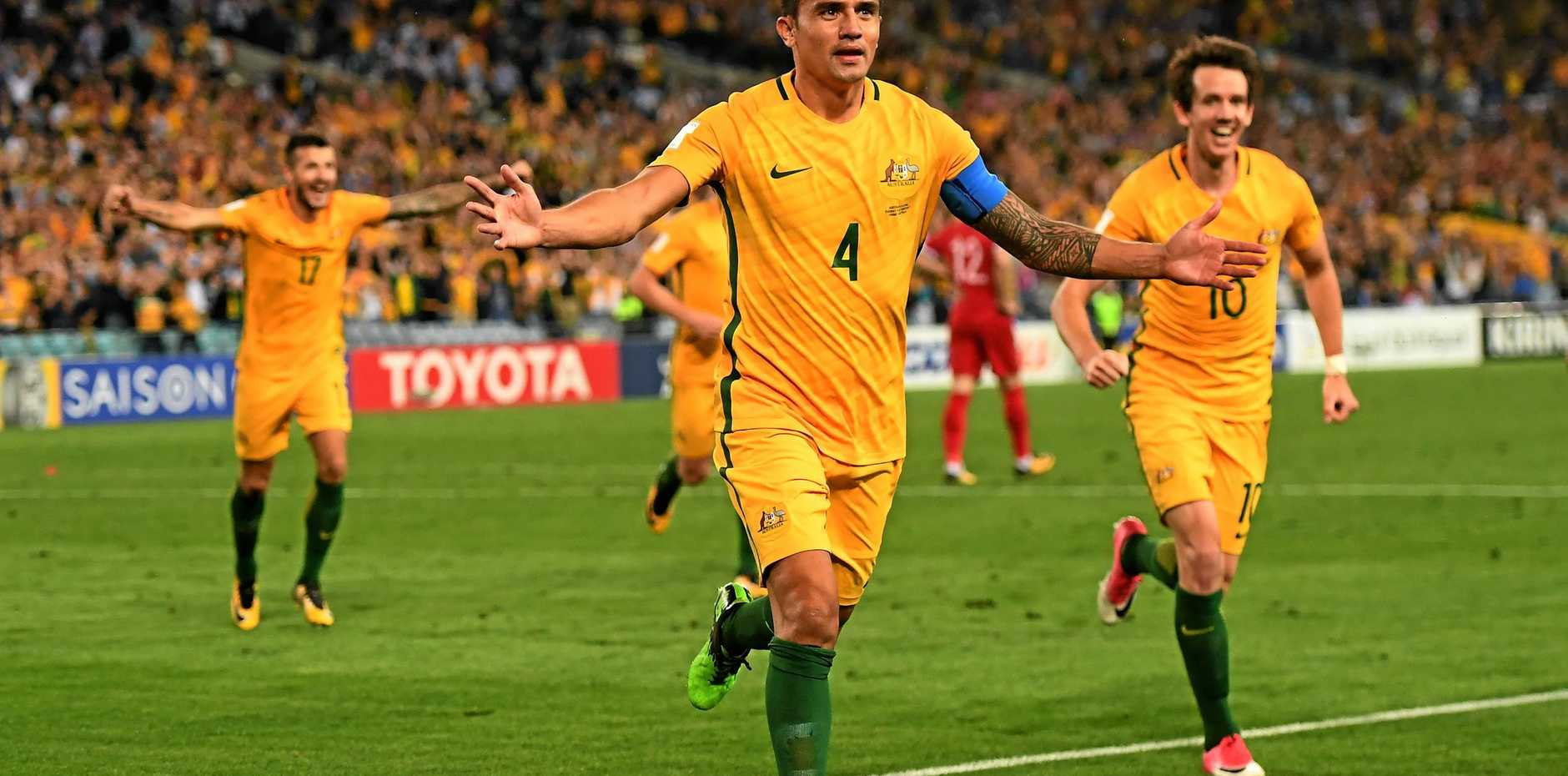COMETH THE HOUR: Australia's Tim Cahill celebrates after scoring in extra time during the 2018 World Cup qualifying football match between Australia and Syria at Stadium Australia in Sydney, Tuesday, October 10, 2017.