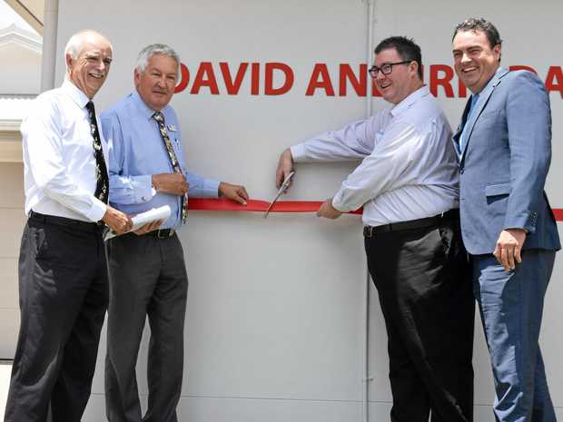 RIBBON CUTTING: Former councillor and project chair Dave Perkins, MADEC's Thomas Block, Dawson MP George Christensen and Whitsunday MP Jason Costigan at the official opening of the Irie and David Dalrymple House.