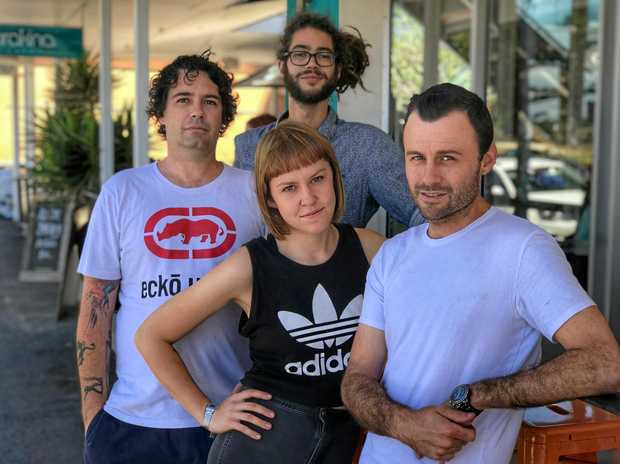 CAFE FURY: Ben, from the Terrace Espresso Bar, Torakina Cafe owner Anthony Kerrison, Footbridge Cafe manager Bea Adalian and Dolphin Cafe owner Gary Deller are in furious agreement against paid parking.