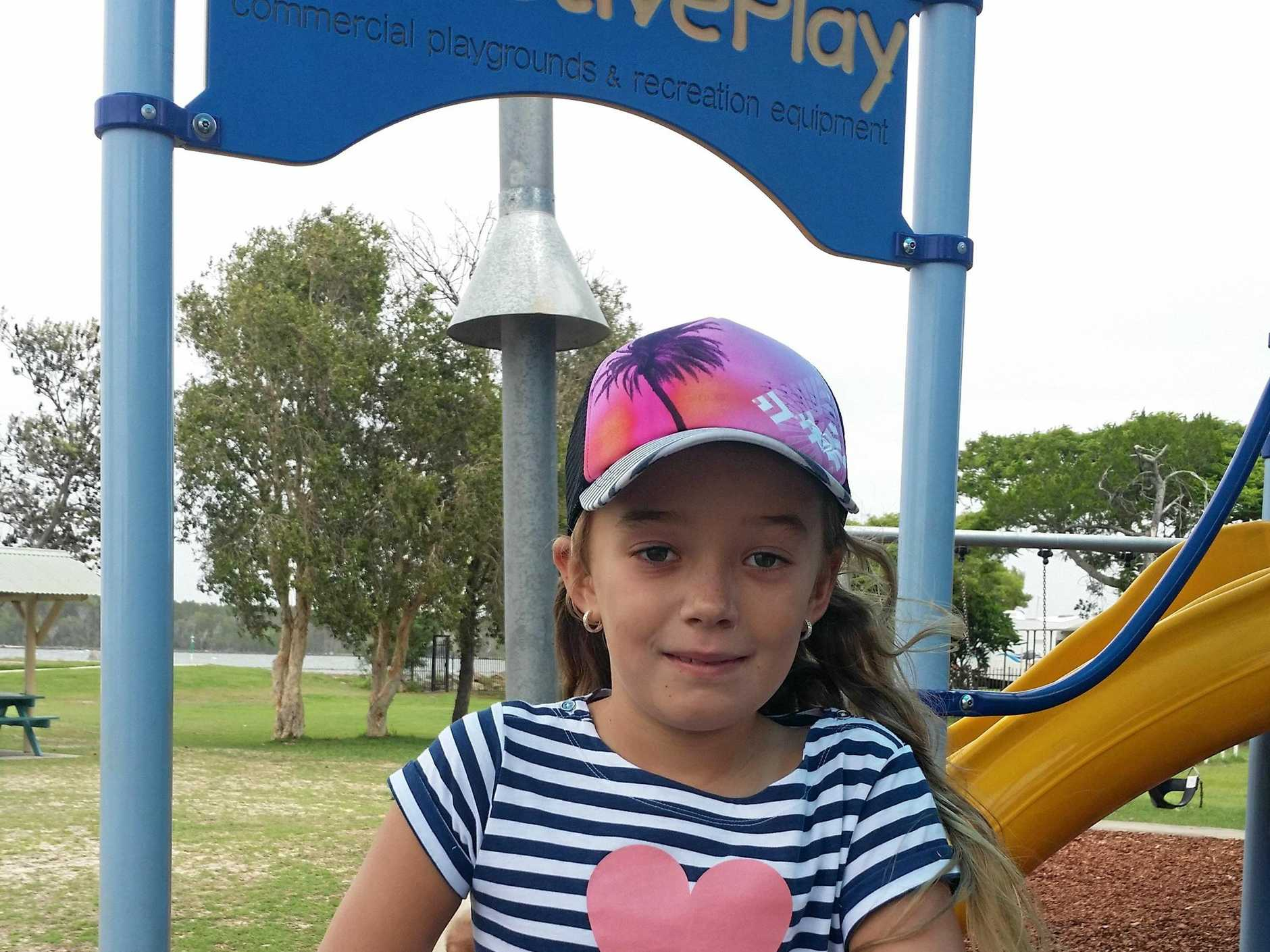 BETTER DAYS: Sasha Berry on the playground just months before her diagnosis.