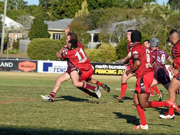 BRING DOWN: Wests' Tyson Whaleboat tackles Isis winger Jacob Klaasen. He is now president of the club.